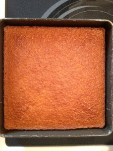 The cake is ready for almonds to be sprinkled on.