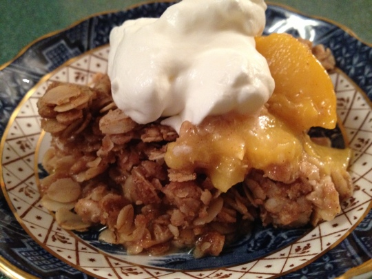Fresh peaches in a cinnamon oatmeal crumble
