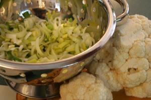 Thinly cut leeks and break cauliflower into florets