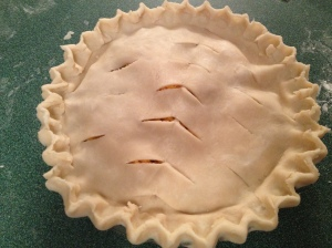 To get a little flair on your pie crust, use the pinch method illustrated below.