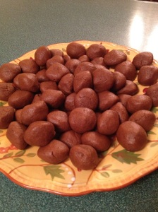 Roll them into walnut-sized balls and dip the tops into the remaining 2 tbsp. sugar