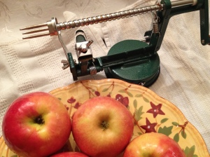 The apple fits on the end prongs and by simply turning the handle, the apple is peeled and cored in one shot!