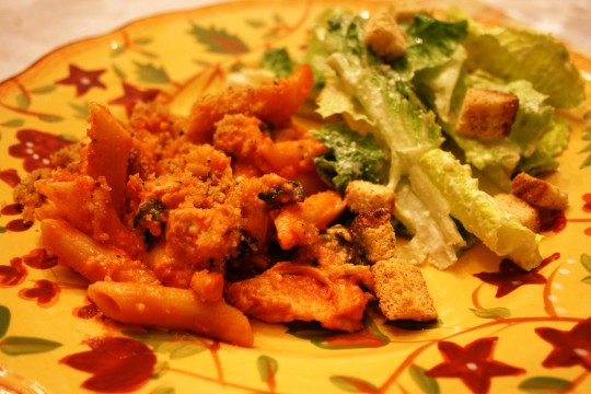 A simple family dinner item that has a lightly creamy tomato sauce, spinach and chicken.