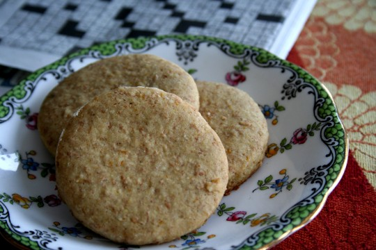 "Whole wheat never tasted this good!  Think of these as like the ""Digestive"" brand cookies with the whole wheat fibrousness,  but with a hint of orange and almond.  If these were for a fancier occasion (beyond Sunday crossword time) I would drizzle on a little frosting and maybe decorate with some crushed almonds"