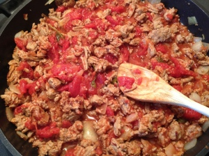 Break the canned tomatoes up when in the frying pan.  I like the uneven chunks rather than using a puree.