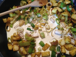 The softened curried veggies and apples are stirred together with the cream and milk